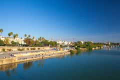 Sunset on the Guadalquivir river. Seville,Spain. Seville, Spain - November 19,2016: Sunset on the Guadalquivir river. In addition, the river was heavily defended royalty free stock image