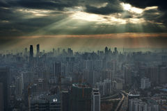 Sunset in Guangzhou. The sunset in the west, the sun through the clouds, sprinkle to the west of the city of Guangzhou, a plane calmly over, the inner ring road stock images