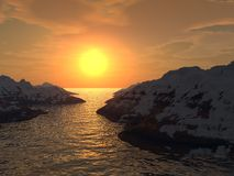 Sunset in a gulf. Yellow sunset in a gulf. Snow tops of mountains Royalty Free Stock Image
