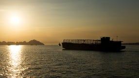 Sunset Ha long bay. Sunrise Ha long bay Silhouettes of Rocks and cargo ships Vietnam Royalty Free Stock Photography
