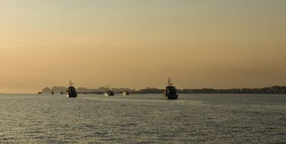 Sunset Ha long bay. Sunrise Ha long bay Silhouettes of Rocks and  ships Vietnam Stock Photo