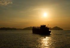 Sunset Ha long bay. Sunrise Ha long bay Silhouettes of Rocks and ships Vietnam Royalty Free Stock Image