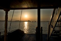 Sunset Ha long bay - View from sightseeing boat. Sunrise Ha long bay Silhouettes of Rocks and ships Vietnam Royalty Free Stock Photo