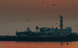Sunset at Haji Ali Mosque Mumbai. Built in 1431, this Pir Haji Ali Shah Bukhari`s tomb and Mosque is a handsome example of Indo Islamic architecture. This shot Royalty Free Stock Photo
