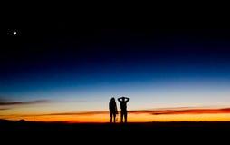 Sunset at Haleakala volcano, Maui . Couple at the top of Haleakala volcano watching sunset, Maui, Hawaii Stock Photo
