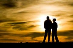 Sunset at Haleakala volcano, Maui 4. Couple at the top of Haleakala volcano watching sunset, Maui, Hawaii Stock Photos