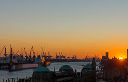 Sunset at the Hamburg harbor Royalty Free Stock Photos