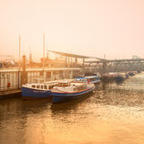 Sunset in Hamburg on a misty evening by Elbe river Stock Photography