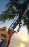 Sunset and hammock Stock Image