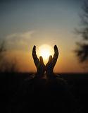 Sunset in hands Stock Photography
