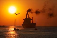 Sunset in the harbor Stock Photography