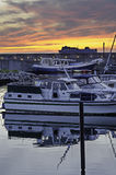 Harbor sunset. Sunset in the harbor/harbour. Boats in the foreground Stock Images