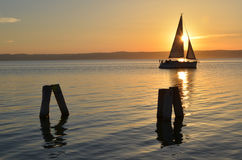 Sunset in the harbor. Lake and boats. Stock Images