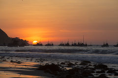 Sunset on the harbor of Mancora, Peru Royalty Free Stock Photo