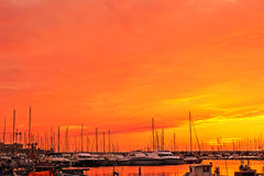 Sunset at the harbor Stock Photography