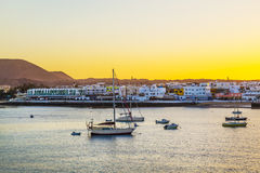 Sunset in the harbor  with sailing Royalty Free Stock Images