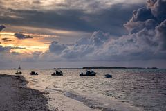 Sunset at the harbor with small boats. At the tropical island in Maldives Stock Photography