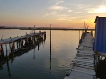 Sunset Harbor. Sunset seen from the old harbor built in wood royalty free stock images