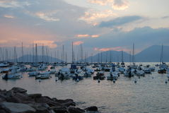 Sunset on harbour Stock Image