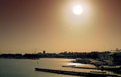 Sunset in the harbour. View of the harbour of Valencia Stock Images