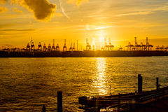 Sunset at the harbour of Hamburg Royalty Free Stock Photo