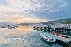 Sunset on harbour of Lerici in summer Stock Image
