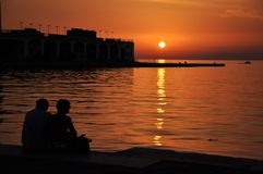 Sunset in harbour Stock Photos