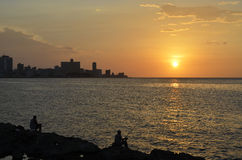 Sunset in Havana (Cuba). Sunset, skyline, malecon and fishermen in Havana (Cuba Stock Photo