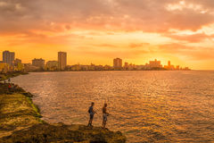 Sunset in Havana with fishermen on the foreground Stock Images