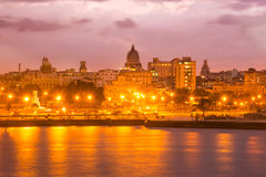 Sunset in Havana with a view of the Capitol. And illuminated street lamps Stock Photos