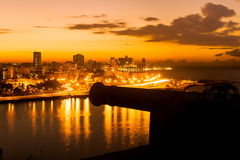 Sunset in Havana with a view of  the city skyline and an old spa. Nish cannon on the foreground Stock Image