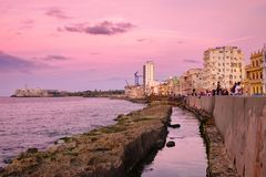 Sunset in Havana with a view of the ocean. The Malecon seawall and El Morro castle in Havana at sunset Stock Images