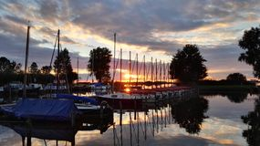 Sunset at the haven. A beautiful sunset at a sailing ship haven royalty free stock images