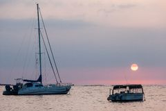 Boats at Sunset. Sunset in Hawaii, view from the beach of boats royalty free stock photography