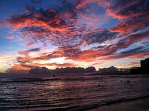 Sunset on Hawaiian Beach. Sunset at Hawaii's Waikiki Beach Stock Photo