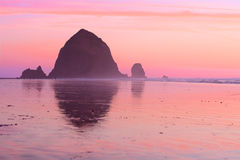 Sunset at Haystack Rock Stock Photography