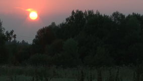 Sunset. HD 1080 time lapse clip of rural summer sunset stock video