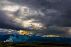 The sunset and heavy clouds stock photography
