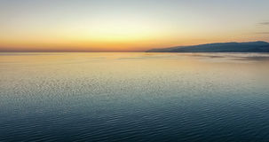 Sunset from the height of bird flight. Sunset over the sea from the height of bird flight Royalty Free Stock Images