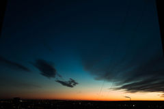 Sunset from a height. Sunset overlooking the city at night and the horizon Royalty Free Stock Images
