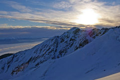 Sunset in high mountains. Sunset with inversion in high mountains in winter royalty free stock photo