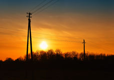 Sunset with high voltage power lines Stock Images