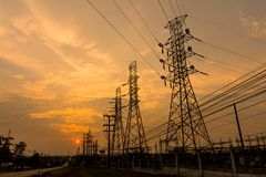 Sunset high voltage. Silhouette of columns and high voltage wires In the power supply station There is a sunset background stock images