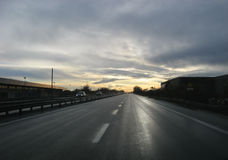 Sunset on highway Royalty Free Stock Photos