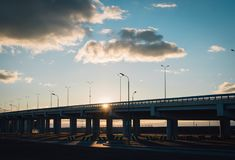 Sunset on the highway. Sunset with beautiful big clouds seen on the highway royalty free stock photography