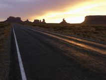 Sunset on highway in Monument Valley. Royalty Free Stock Photo