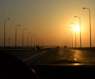 Sunset on highway Royalty Free Stock Image