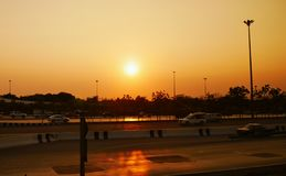 Sunset from the highways. The sunset casts a golden reflection on the main highways of Bangkok, Thailand stock images