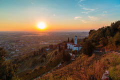 Sunset from a hill with a church down to the vineyards Stock Photos