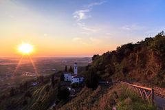 Sunset from a hill with a church down to the vineyards Stock Image